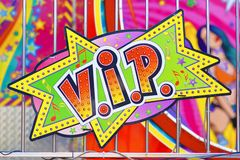Colorful retro comic style sign saying `V.I.P.` on funfair attraction. Heidelberg, Germany - May 2019: Colorful retro comic style sign saying `V.I.P.` on funfair stock photography