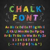Colorful retro hand drawn alphabet letters drawing with chalk on black chalkboard. Bright colorful retro hand drawn alphabet letters drawing with chalk on black Royalty Free Stock Photography
