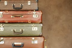 Colorful retro suitcase on a beige background Stock Images