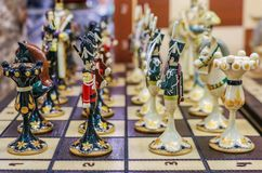 Colorful retro traditional Russian hand carved and painted wooden chess set in souvenir shop in Saint Petersburg Russia. Colorful retro traditional Russian hand stock images