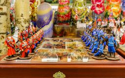 Colorful retro traditional Russian hand carved and painted wooden chess set in souvenir shop in Saint Petersburg Russia. Colorful retro traditional Russian hand stock photos