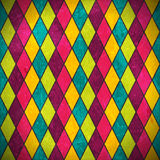 Colorful rhombus grunge background. Geometric pattern made of rhombuses in various bright colors overlaid with grunge elements and scratches to give it an aged Stock Illustration