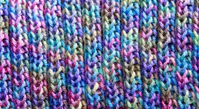 Colorful Rib Stitch Knit Pattern. Close up photo of a colorful handmade scarf knit in a rib stitch pattern Royalty Free Stock Photo