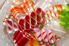 Colorful ribbon candy in a dish Stock Photos