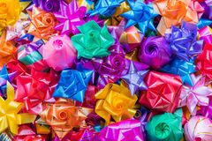 Colorful ribbon flowers for giving alms to make merit in Thai`s. Religious traditional Stock Images
