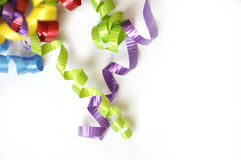 Colorful ribbons. Curled up on white space Stock Image