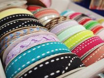 Ribbons. Colorful ribbons display on a shelf, ready to sell and to sew royalty free stock photo