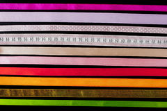 Colorful ribbons horizontal on the black background Royalty Free Stock Image