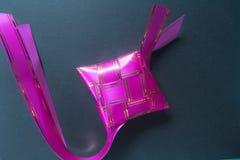 Dark pink ribbon of ketupat