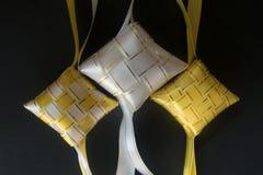 Yellow and white ribbons of ketupat. close up