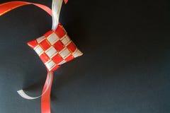 Red and white ribbon of ketupat