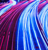 Colorful ribbons over night streets Stock Image
