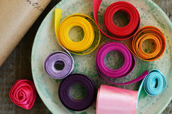 Colorful ribbons and wrapping paper for floristics and decor Royalty Free Stock Photos