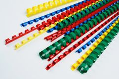 Colorful ring binding spine. Colorful plastic multi-ring paper binding spine on white background Stock Images