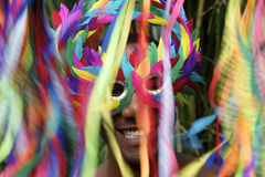 Colorful Rio Carnival Smiling Brazilian Man in Mask. Rio Carnival scene features smiling Brazilian man in colorful mask with streamers stock photos