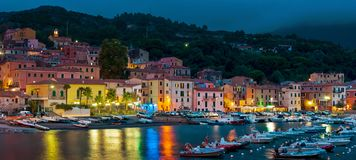 The colorful Rio Marina at night. Lights and colors on the night party in Rio Marina, a small Tuscan village on the island of Elba royalty free stock photo