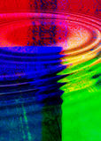 Colorful Ripples. An abstract design of ripples with the reflection of a colorful design in them Royalty Free Stock Image