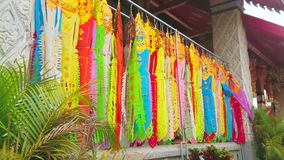 Lanna banners, Wat Phra That Hariphunchai Temple, Lamphun, Thailand. The colorful ritual Lanna flags hang on the terrace of the Viharn Luang of Wat Phra That stock video footage
