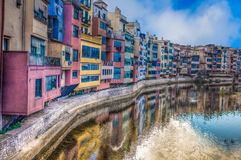 Colorful river-front houses of all shapes and sizes, painted in royalty free stock images