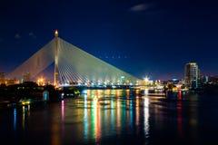 Colorful River & Golden Cable Bridge in Bangkok Stock Photo