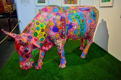 Colorful Rizzi cow. A colorfully painted plastic cow on display, created by the artist James Rizzi Royalty Free Stock Photo