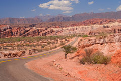 Stunning Colorful Road. Road through colourful polychromic mountains in Northern Argentina Stock Image
