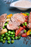 Colorful roast vegetables and grilled steak Stock Image