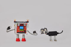Colorful robot and machanical black cat character. Funny electric components toys on gray background. Copy space. Stock Image