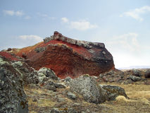 Colorful rock. A colorful rock. This bizarre landscape is south of Reykjavik and is called Rauðhólar (red hills). The rocks are remainders of a cluster of stock image
