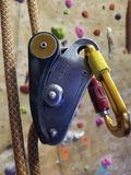 Colorful rock climbing equipment hanging by rope stock photography