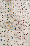 Colorful Rock Climbing Wall with Ropes Stock Image