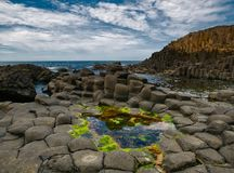 Colorful rock formations of Causeway with the atlantic stock photos