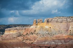 Colorful rock formations under a stormy sky at Ghost Ranch in the American Southwest stock photos