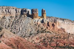Colorful rock formations and towers in the desert landscape of Ghost Ranch in the American Southwest. Colorful cliffs and rock pinnacles in Ghost Ranch, Abiquiu royalty free stock photography