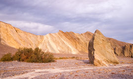Colorful Rock Wall and Drainage Channel Death Valley Stock Image