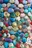 Colorful Rocks. Colorful hand painted rocks glued to a cement wall Stock Image