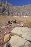 Colorful Rocks Below a Mountain Ridge Royalty Free Stock Images