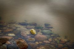 Colorful rocks at the bottom of a lake stock image