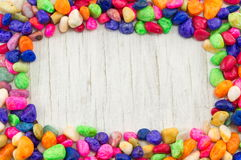Colorful rocks decorated wooden frame Stock Image