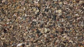 Colorful rocks and flowing water stock footage