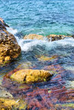 Colorful rocks in sea Royalty Free Stock Photos