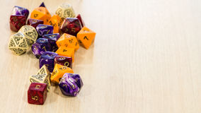 Colorful roleplaying dice scattered on a table Stock Photography