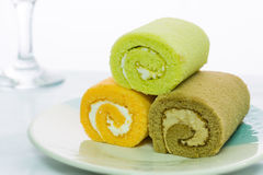 Colorful roll cake on dish . Royalty Free Stock Images