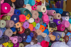 Colorful Roll Of Cotton Fabrics Sale In The Market. Stock Photography