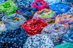 Colorful rolled scarves. Exposed for sale Stock Image