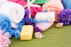 Towels. Colorful rolled towels with flowers and soaps closeup picture Stock Photo