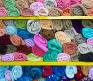 Colorful rolled towels. On shelves in a shop Stock Photography