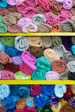 Colorful rolled towels. On shelves in a shop Stock Images