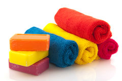Colorful rolled towels with soap Stock Image