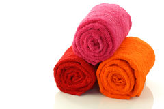 Colorful rolled up and stacked bathroom towels Royalty Free Stock Image